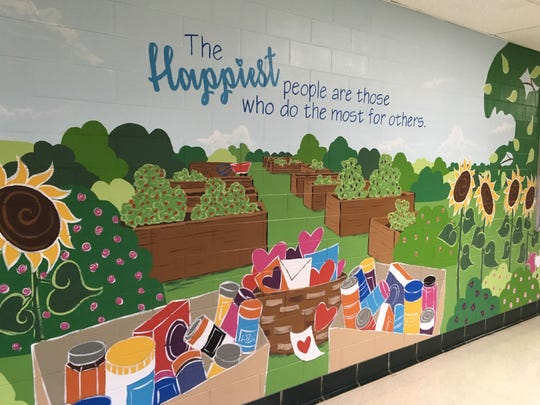 Community service is just one scene depicted as 2nd and 3rd graders at Jefferson Elementary School recently joined parent volunteers in transforming school hallways into a magical scene of the many events that take place each year.