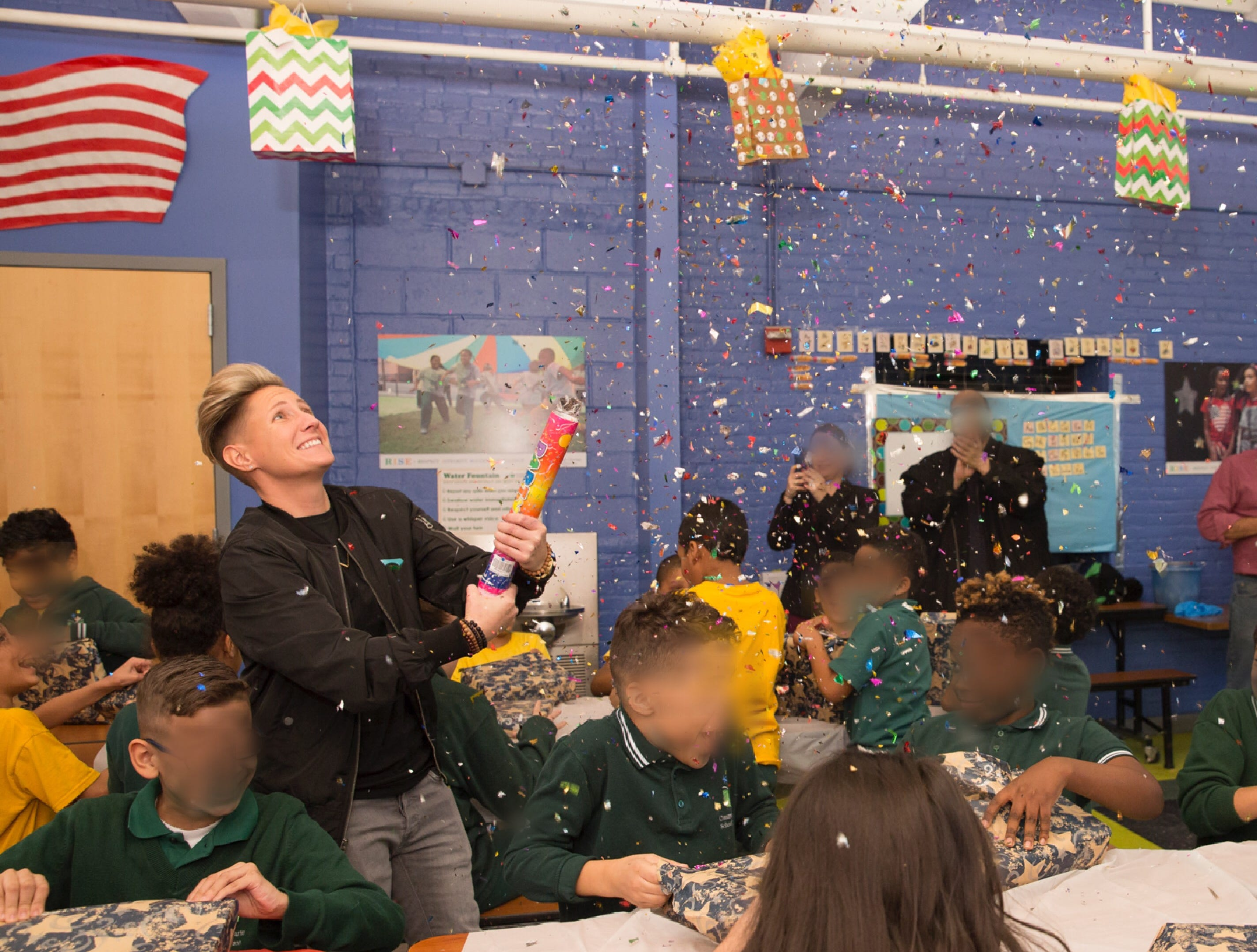 """A Santa Claus of sorts, New Brunswick teacher Jennifer Olawski is ensuring that every single of of her more than 450 students will receive a gift this holiday season. Continuing a program she began in her former school (pictured here), Olawski, a physical education and health teacher at Livingston Elementary School, created a GoFundMe campaign to raise funds for gifts for the children. This year's effort saw more than $10,000 in donations and the help of many school """"elves."""""""