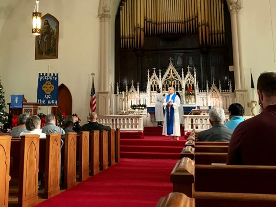 Rev. Minna Bothwell leads a communion service on Sunday, Dec. 9, 2018, at Capitol Park Lutheran Church, in the East Village neighborhood of Des Moines.