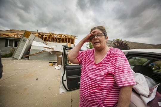 Rodney White placed first in Best Breaking News Photo for his image of Susan Ratliff's, whose home was destroyed on the west end of Bondurant, Iowa, on Friday, July 20, 2018, after a tornado slashed through the town.