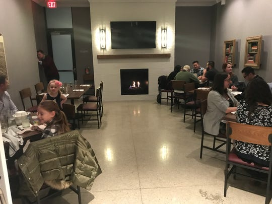 The private party room at Teddy Maroon's features a gas fireplace and seats about 20 people.