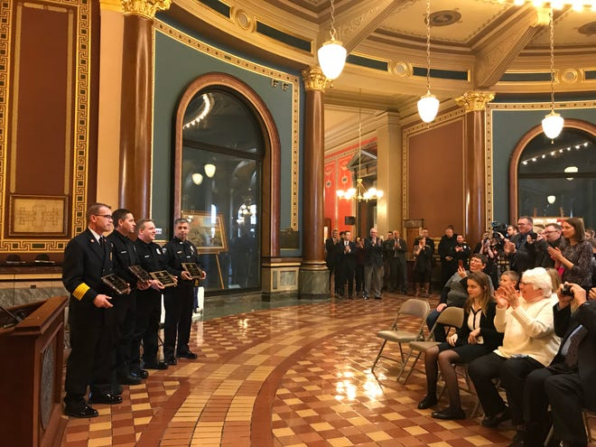 Waukee rescue responders receive applause at the Iowa Capitol on Monday, Dec. 17, 2018 after they were presented with the Sullivan Brothers' Award of Valor.