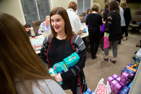 Melissa Knutson, founder of Give Grace Give Hope leads a group making period packs to give to women in need of feminine hygiene products Tuesday, Dec. 11, 2018.