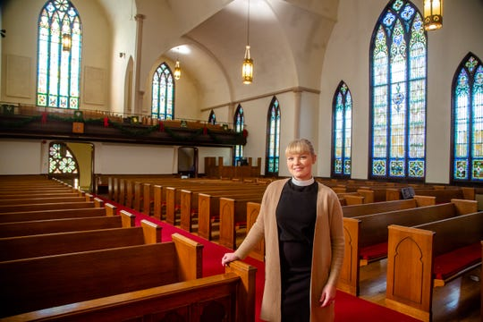 Pastor Minna Bothwell stands for a portrait at Capitol Hill Lutheran Church Thursday, Dec. 6, 2018.