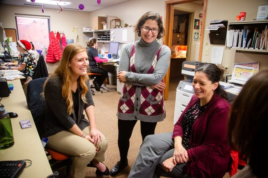Dr. Maria Valdovinos, center, professor of psychology at Drake University speaks with grad students Sam Thurn and Zola Schultz at the Blank Children's Developmental Clinic Wednesday, Dec. 5, 2018.
