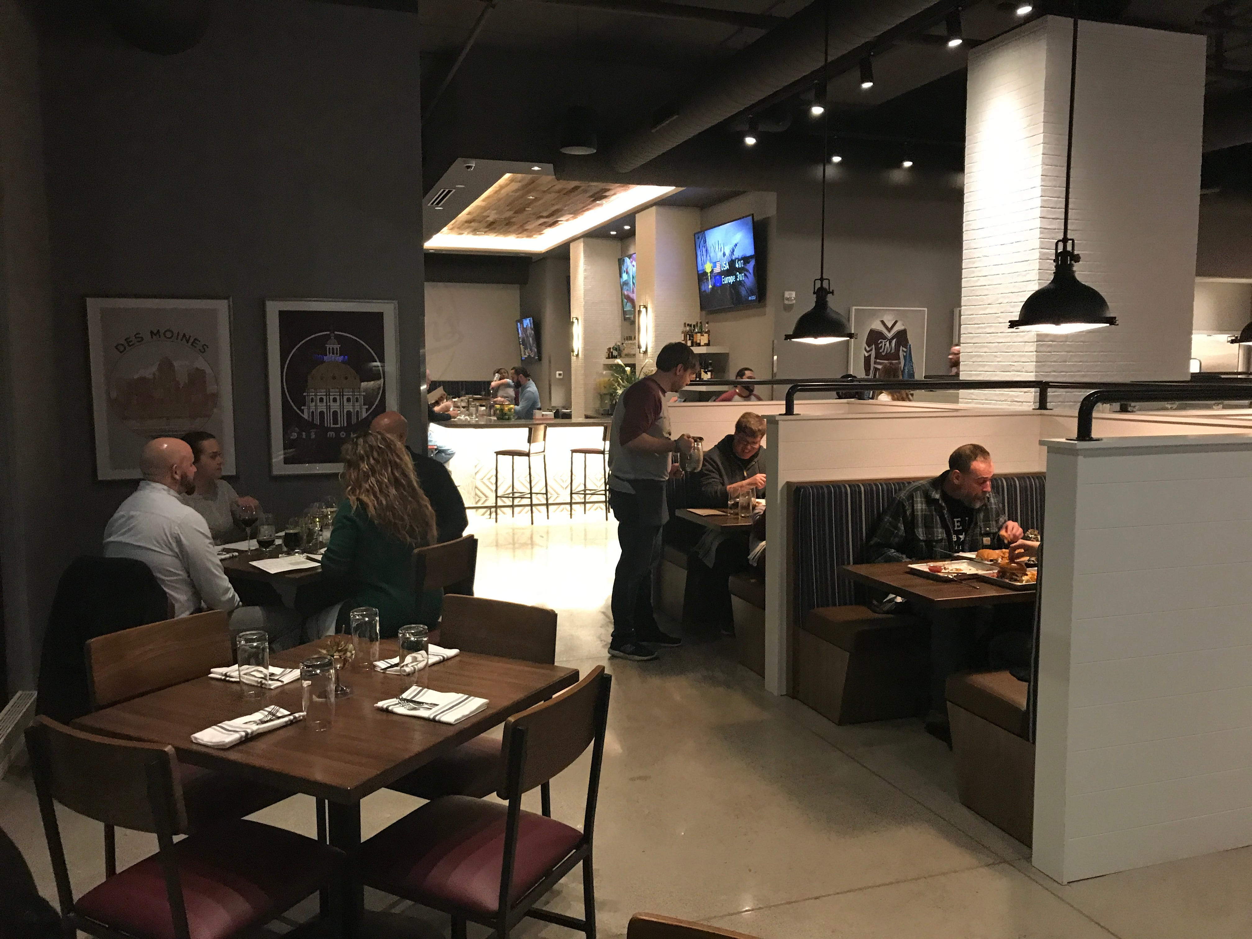 The dining room is filled with spacious booths and tables for four at Teddy Maroon's.