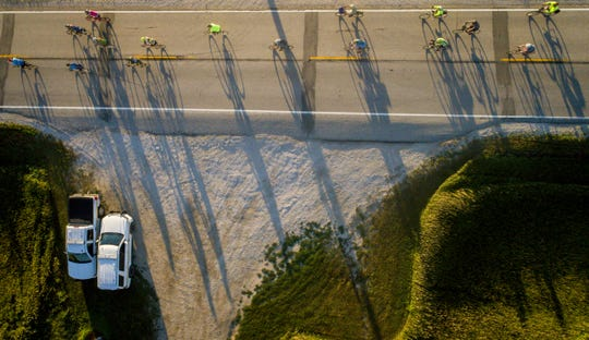 Riders cast long shadows early morning outside Grand Junction, Iowa, Tuesday, July 24, 2018, as RAGBRAI 2018 heads to the overnight town of Ames.