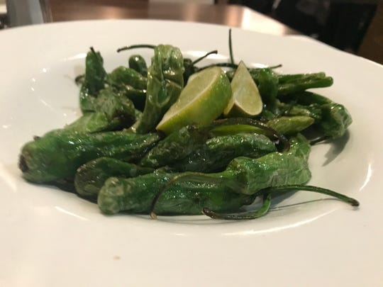 Blistered shishito peppers with salt and lime at Teddy Maroon's.