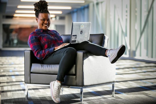 Antoinette Stevens, a cybersecurity analyst at Principal Financial Group, Dec. 14, 2018, in Des Moines, Iowa. She founded Reboot Iowa, a group that helps adults transition into IT careers by teaching basic IT and coding skills .