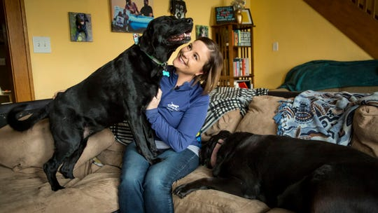 Mindi Callison of Bailing out Benji with two of her dogs at her home in Ames, Iowa, Dec. 14, 2018. Bailing Out Benji and Mindi were featured on a new Animal Planet show about rescues.