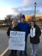 Rev. Minna Bothwell, pictured with CPLC members Alex and Savana Etgeton, protested federal immigration policies at a rally at the Iowa State Capitol.