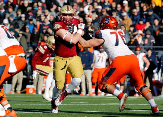 Boston College defensive end Zach Allen tries to get past Syracuse offensive lineman Koda Martin, Nov. 24, 2018.