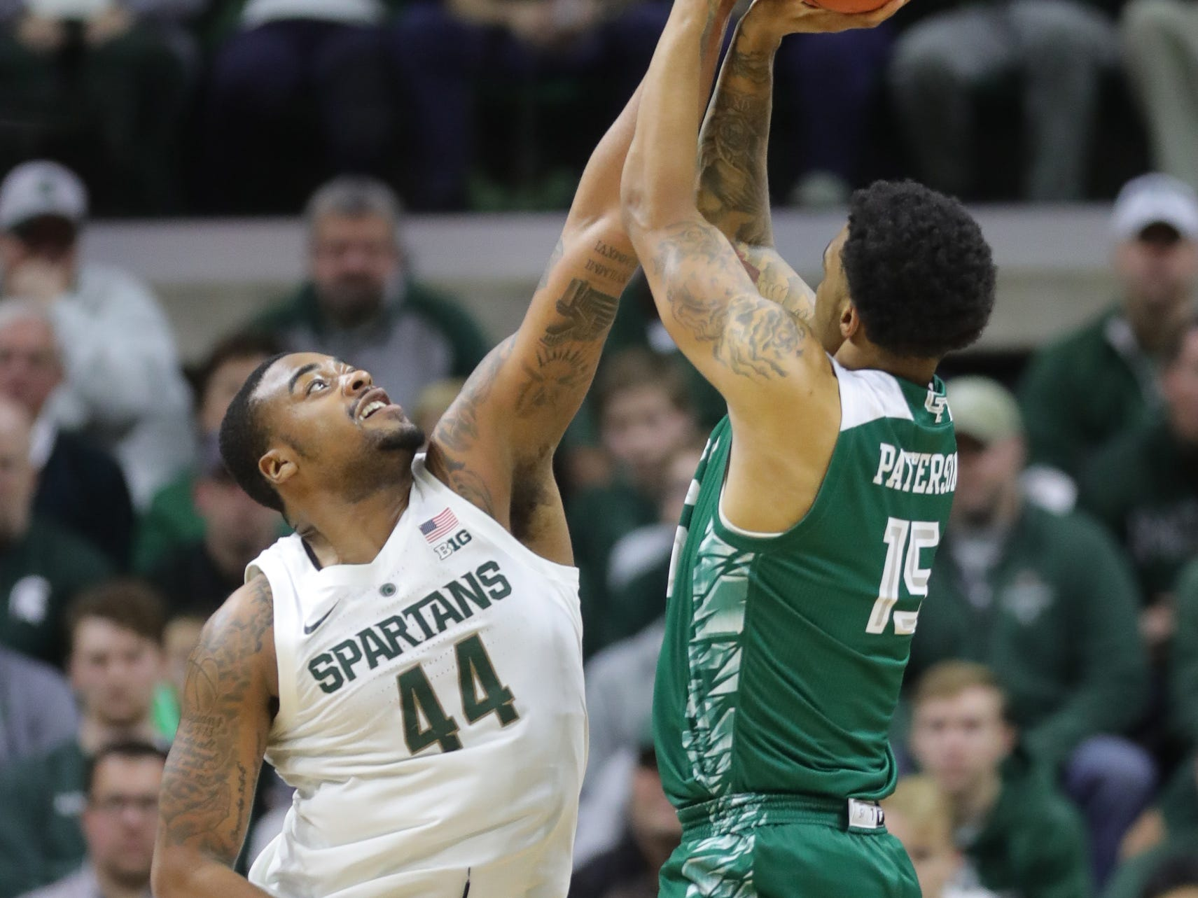 Michigan State forward Nick Ward blocks a shot by Green Bay forward Manny Patterson during the first half Sunday, Dec. 16, 2018 at the Breslin Center in East Lansing.