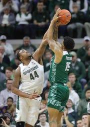 Nick Ward blocks a shot by Green Bay forward Manny Patterson.
