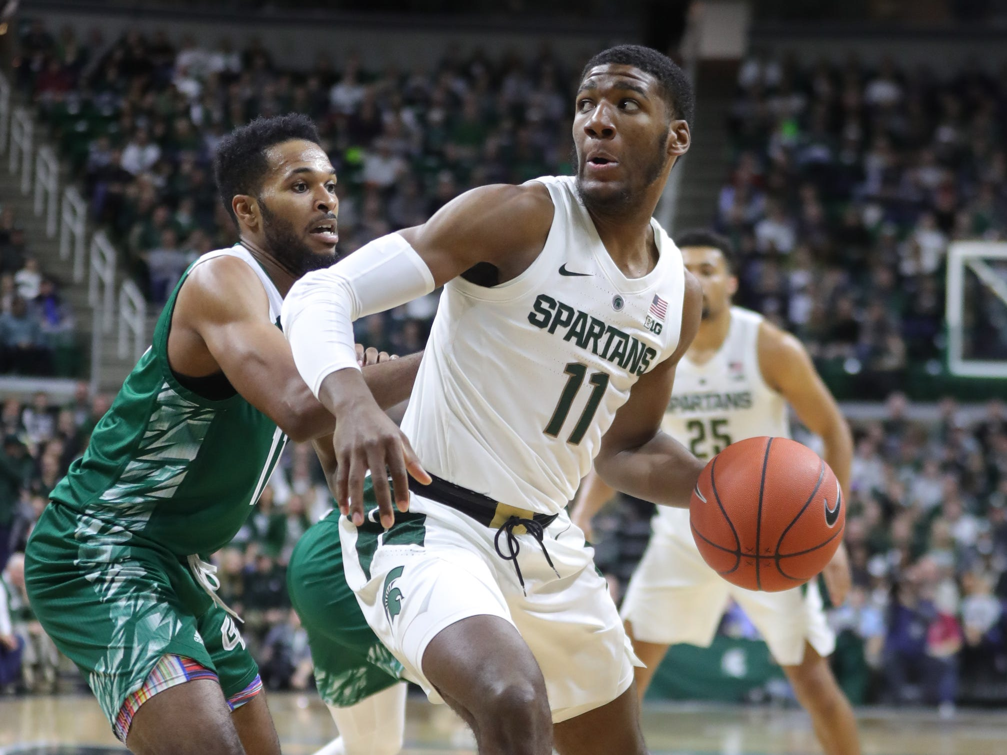 Michigan State forward Aaron Henry drives against Green Bay guard JayQuan McCloud, Dec. 16, 2018 at the Breslin Center in East Lansing.