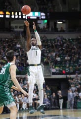 Michigan State guard Joshua Langford scores against Green Bay forward Cody Schwartz, Dec. 16, 2018 at the Breslin Center in East Lansing.