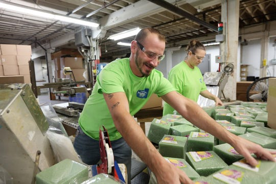 FloraCraft packaging employees prepare floral foam for shipping at its Ludington, Mich. headquarters.