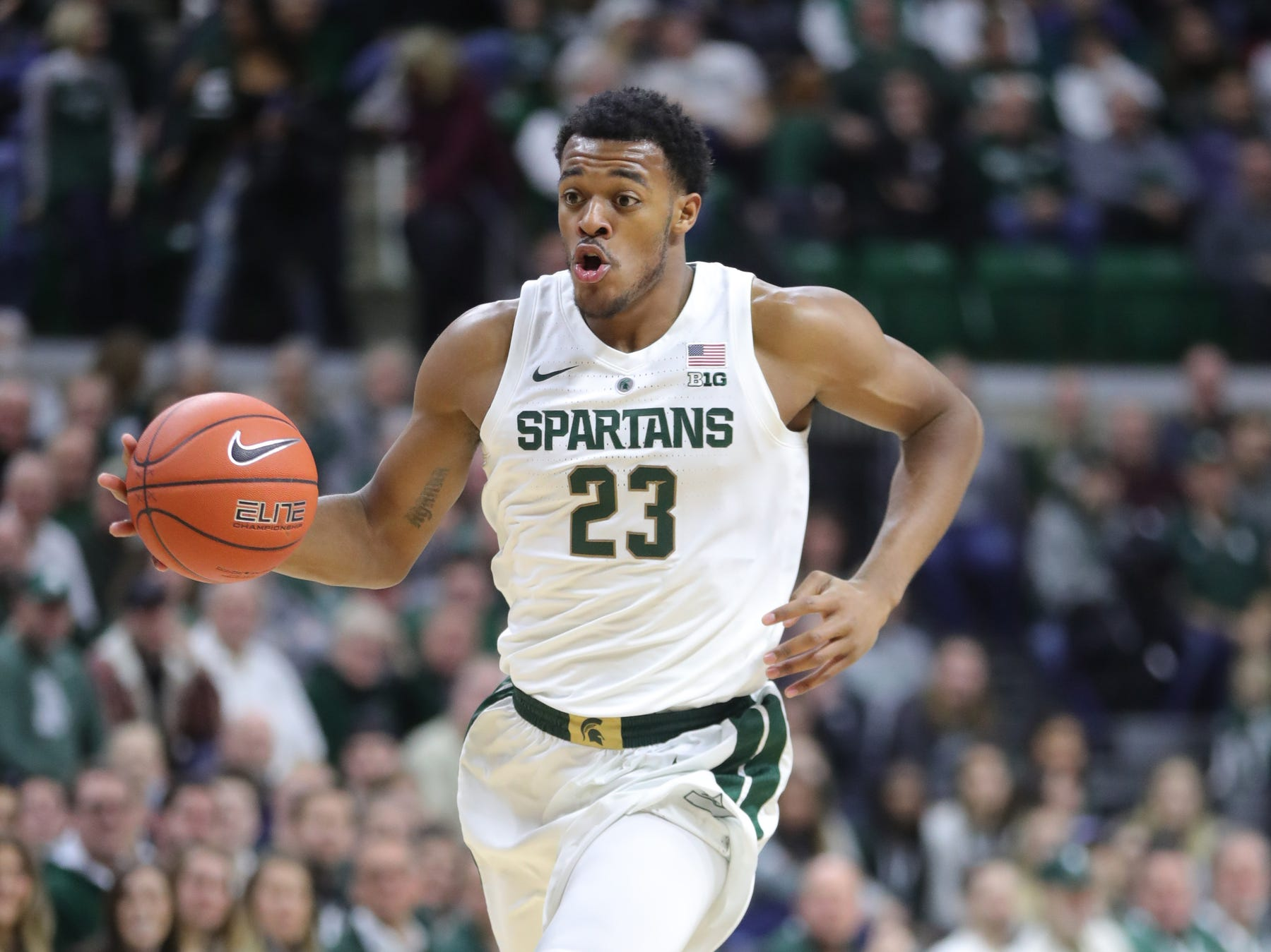 Michigan State forward Xavier Tillman dribbles against Green Bay during the first half Sunday, Dec. 16, 2018 at the Breslin Center in East Lansing, Mich.