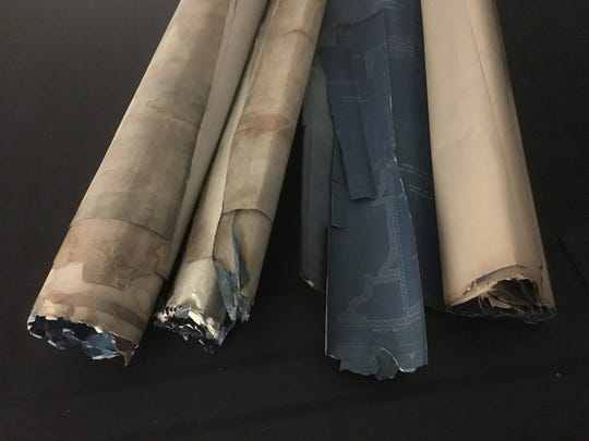 A collection of drawings of the Michigan Central Station currently in the hands of the state's archives. The documents have torn edges and are covered in dirt.