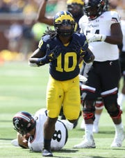 Michigan's Devin Bush Jr. celebrates a sack against Cincinnati, Sept. 9, 2017 at Michigan Stadium in Ann Arbor.
