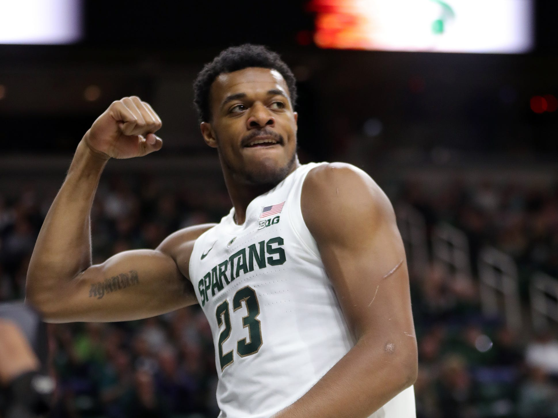 Michigan State forward Xavier Tillman reacts after scoring against Green Bay during the first half Sunday, Dec. 16, 2018 at the Breslin Center in East Lansing, Mich.