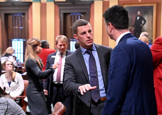 The next Speaker of the House, Lee Chatfield, R-Levering talks with Rep Tom Barrett, R-Charlotte, on the floor of the chamber on Tuesday, Nov 27, 2018.