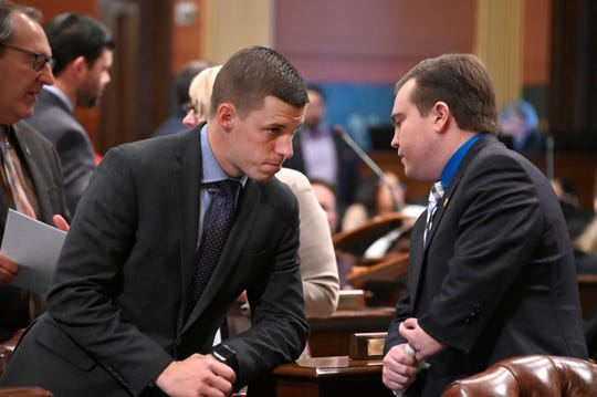 The next Speaker of the House, Lee Chatfield, R-Levering talks with Rep. Brett LaFave, R-Iron Mountain on the floor of the chamber.