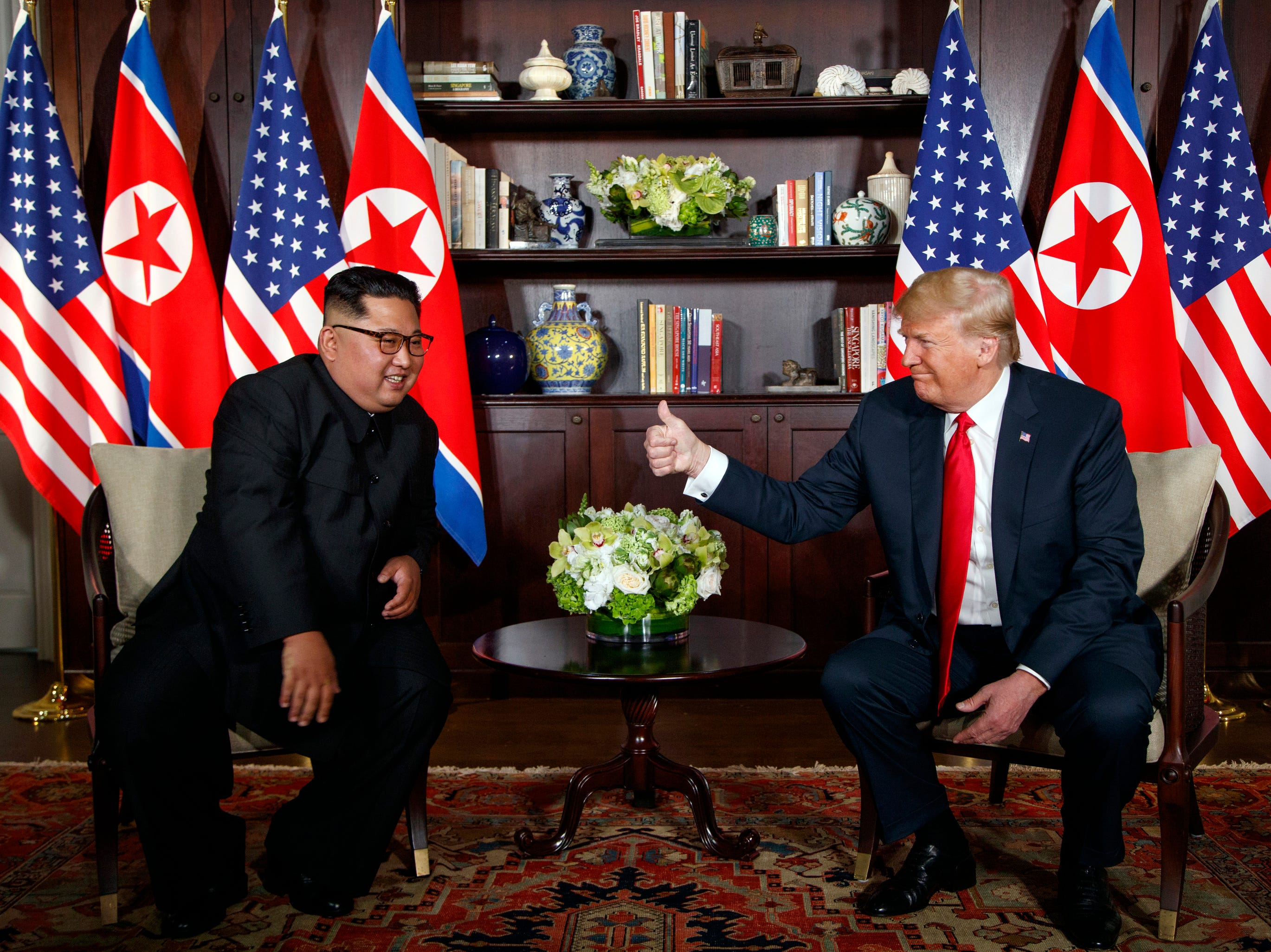 President Donald Trump meets with North Korean leader Kim Jong Un on Sentosa Island in Singapore on June 12, 2018.