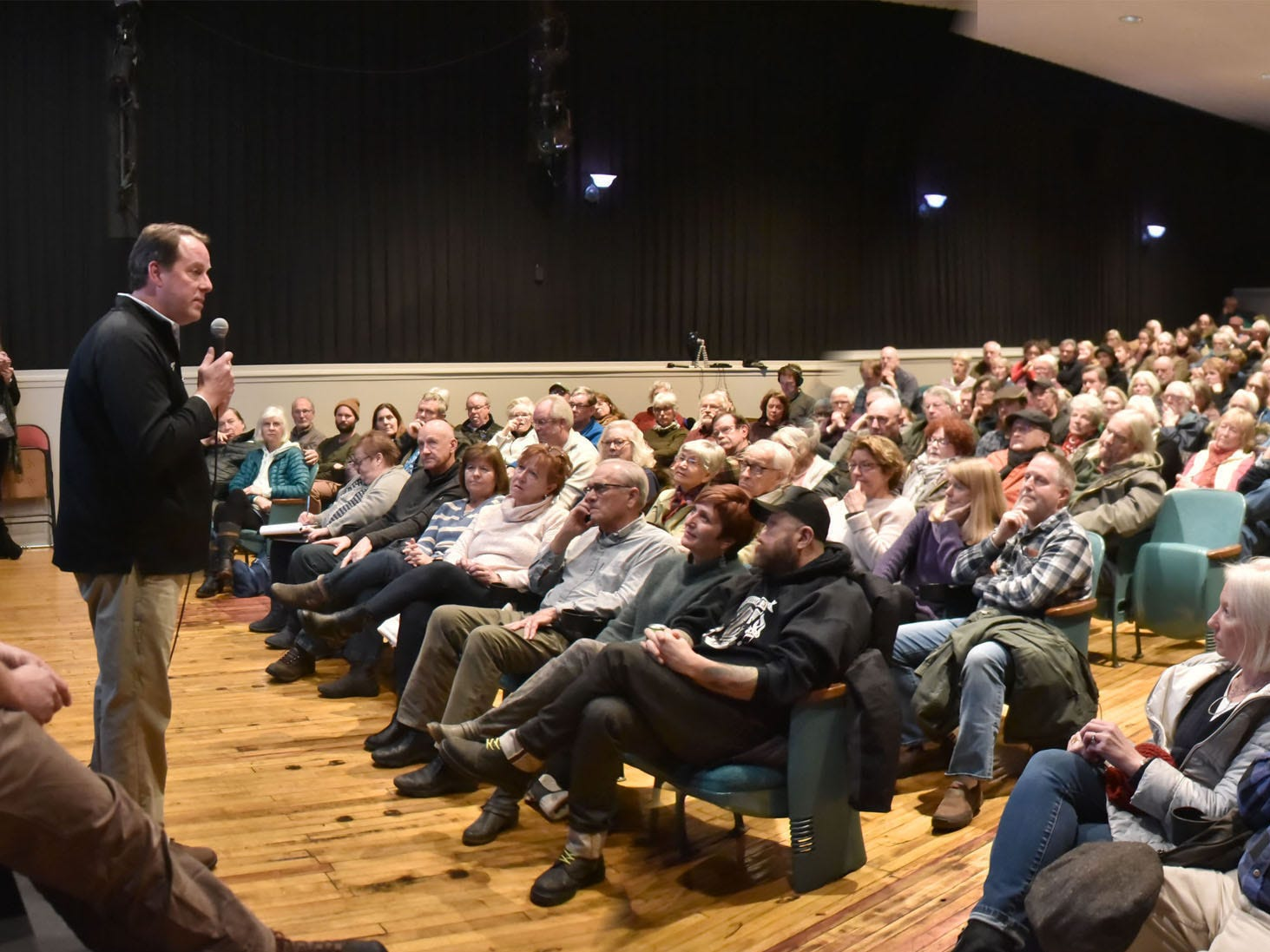 Rick Schmitt of the Garden Theater in Frankfort, Michigan, addresses an overflow crowd at a community forum Tuesday, Dec. 11, 2018 in Suttons Bay. The 200-seat Bay theater is slated for closure at the end of the month, and the forum was held in hopes of finding a way to keep it  operating.