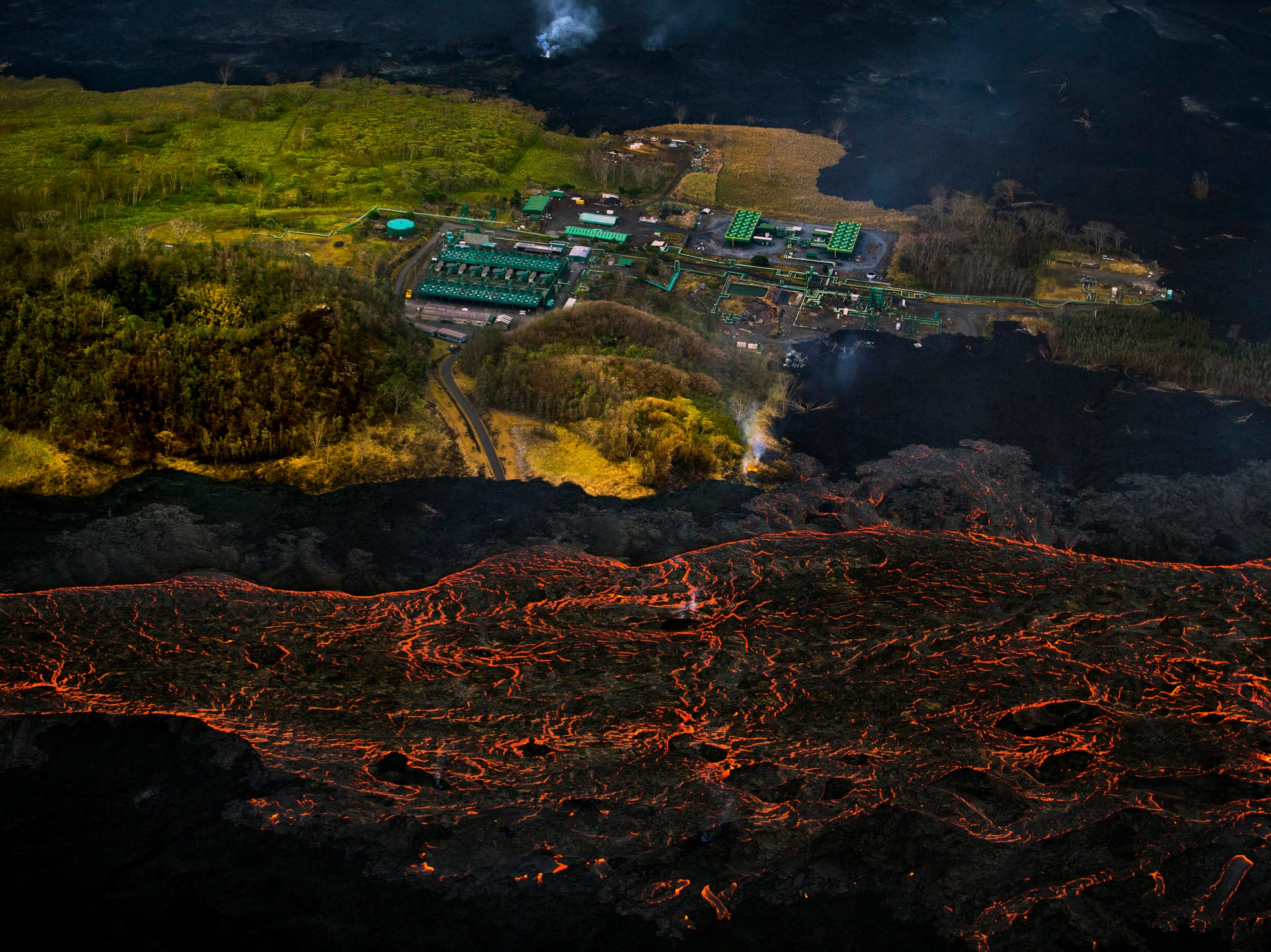 Lava from the Kilauea volcano flows near the Puna Geothermal Venture power plant in Pahoa, Hawaii, on June 10, 2018.