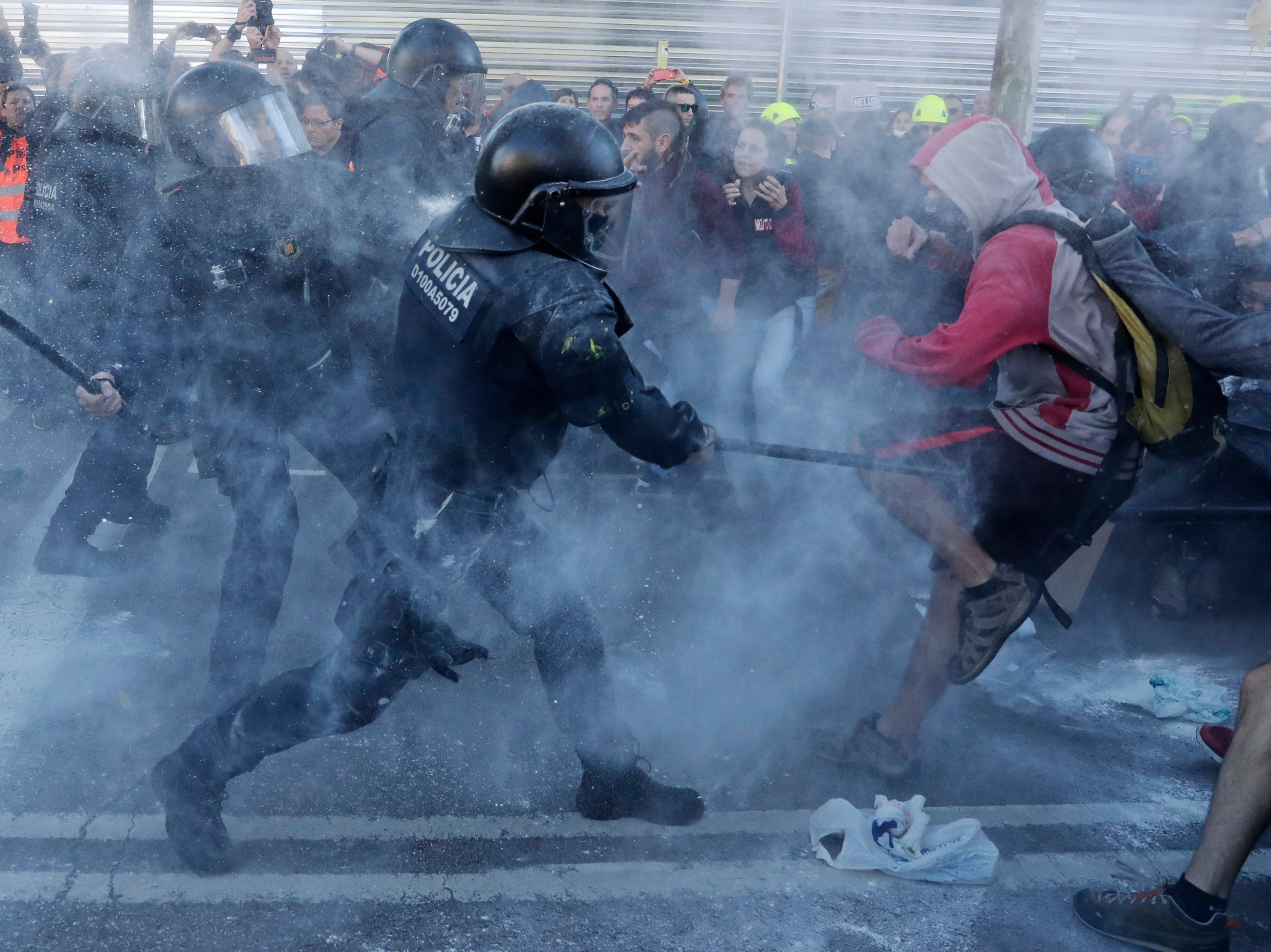 Police charge against protesters during a demonstration by Committees for the Defense of the Republic in Barcelona, Spain, on Nov. 10, 2018. The grassroots group organizes protests in Catalonia to press for their demand for independence.