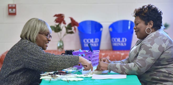 Vice chair person Wilma Barber, left, of Southfield, makes jewelry with Oneika Mobley, of Farmington Hills.