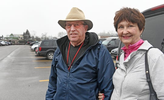 "Weldon and Karen Schwartz of East Grand Rapids chat outside a grocery store in ""Gas Light Village""."