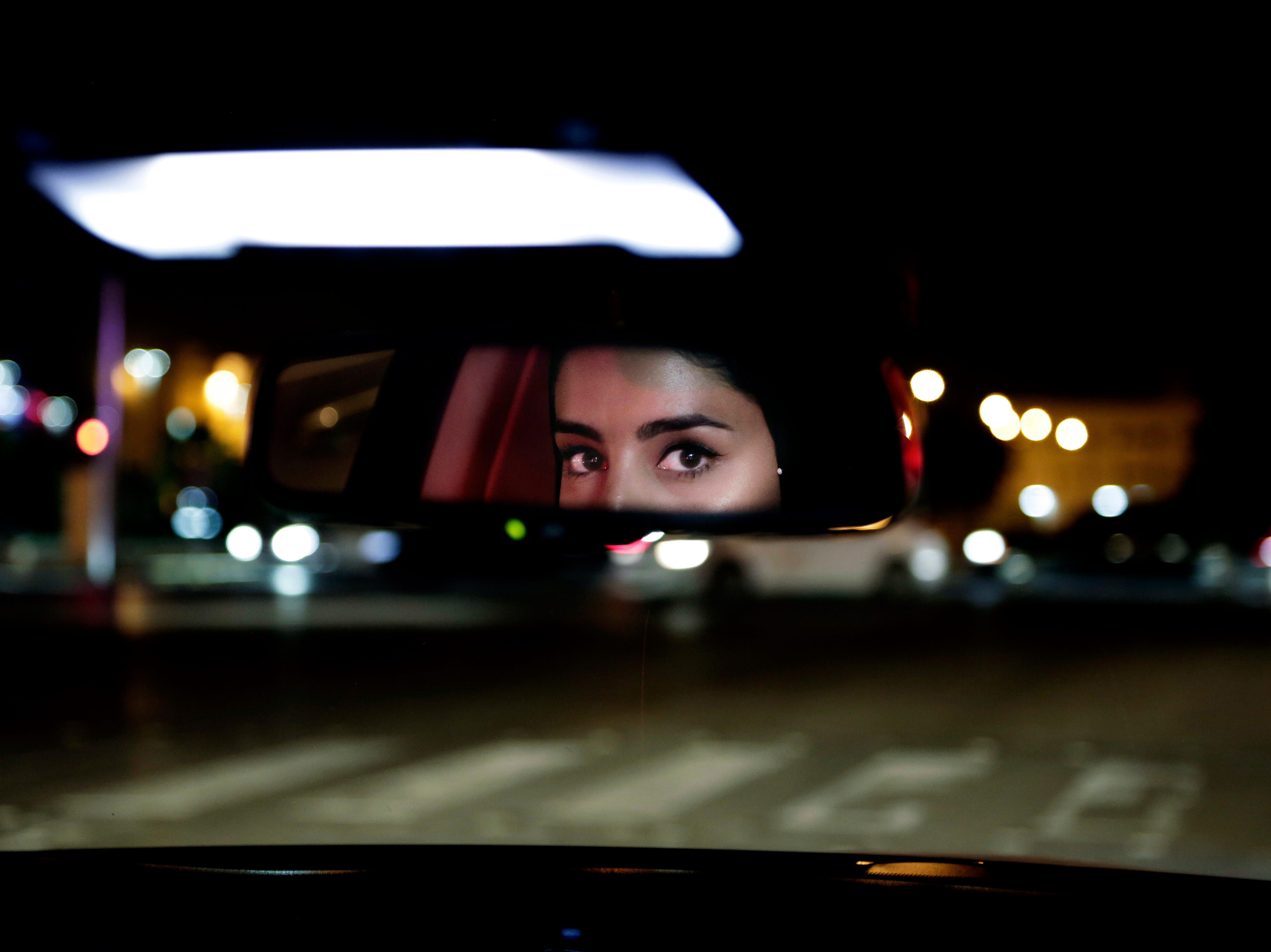 Hessah al-Ajaji drives her car down busy Tahlia Street after midnight for the first time in Saudi Arabia's capital Riyadh on June 24, 2018, just minutes after the world's last remaining ban on women driving was lifted.