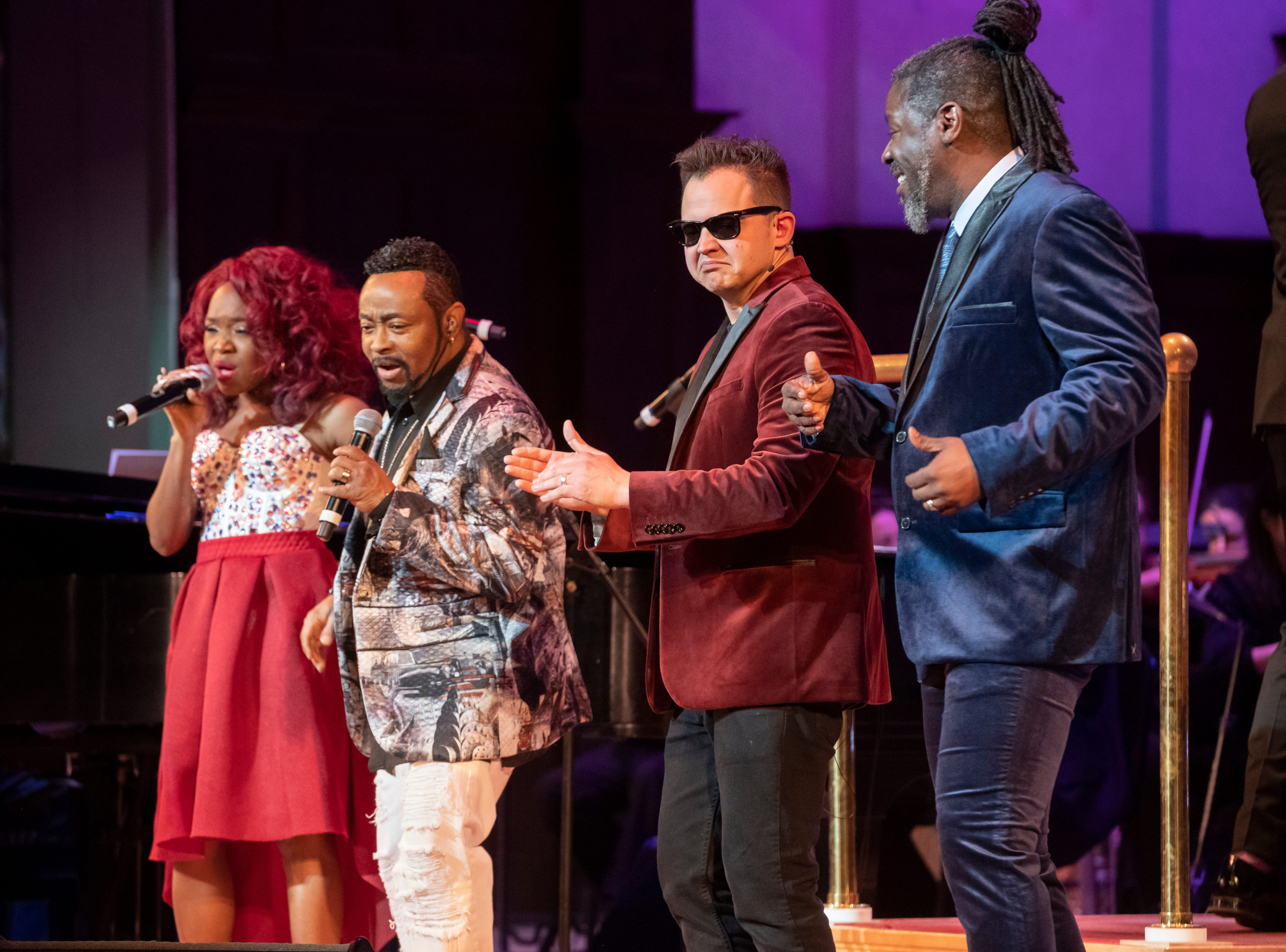 """(From left) Singers Cherri Black, and Condido Lomax perform with ASL performers Sean Forbes and Warren """"Wawa"""" Snipe during the Deaf and Loud Symphonic Experience at the Detroit Symphony Orchestra."""