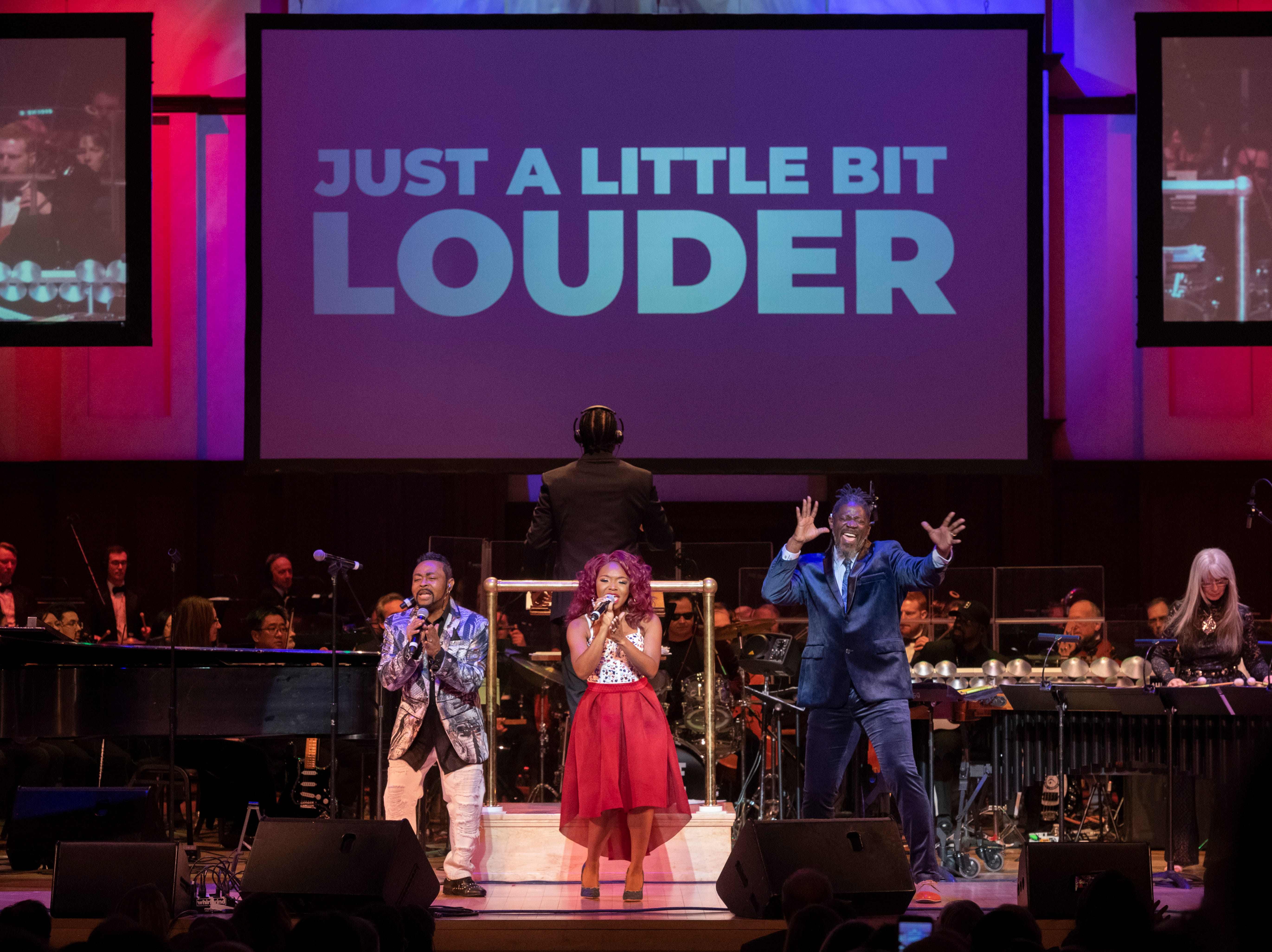 """(From left) Singers Cherri Black, and Condido Lomax perform with ASL performer Warren """"Wawa"""" Snipe during the Deaf and Loud Symphonic Experience at the Detroit Symphony Orchestra , December 16, 2018. Deaf artists and the DSO performed a combination of contemporary and orchestral music in American Sign Language with lyrics projected for each song."""