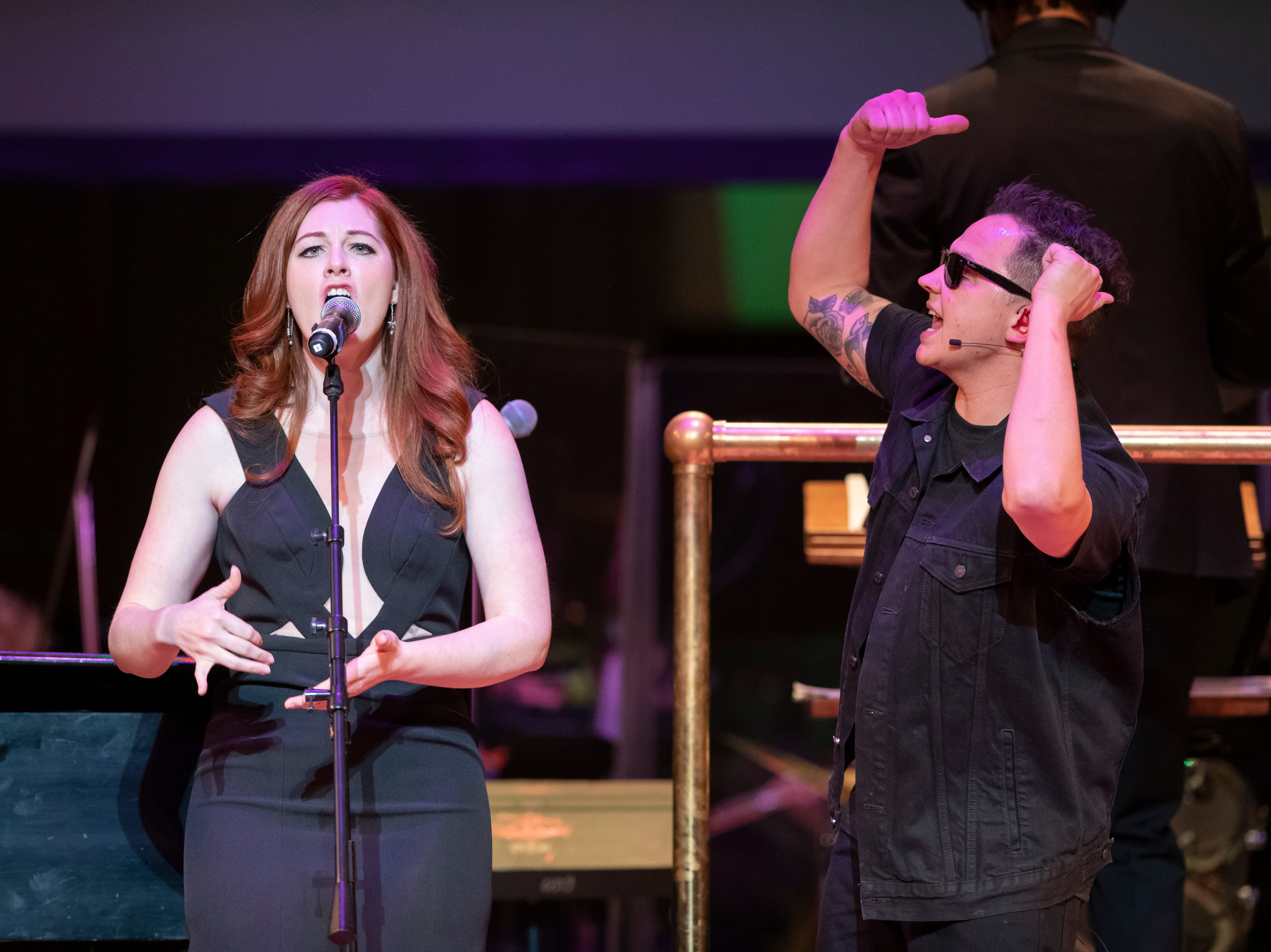 Musicians Mandy Harvey, left, and Sean Forbes perform during the Deaf and Loud Symphonic Experience at the Detroit Symphony Orchestra.