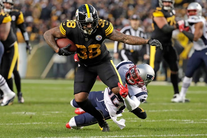 Pittsburgh Steelers running back Jaylen Samuels (38) is tackled by New England Patriots free safety Devin McCourty during the first half on Sunday.