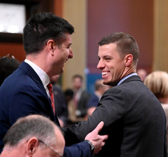 The next Speaker of the House, Lee Chatfield, R-Levering, talks with Rep Tom Barrett, R-Charlotte, on the floor of the chamber on Tuesday, Nov 27, 2018.