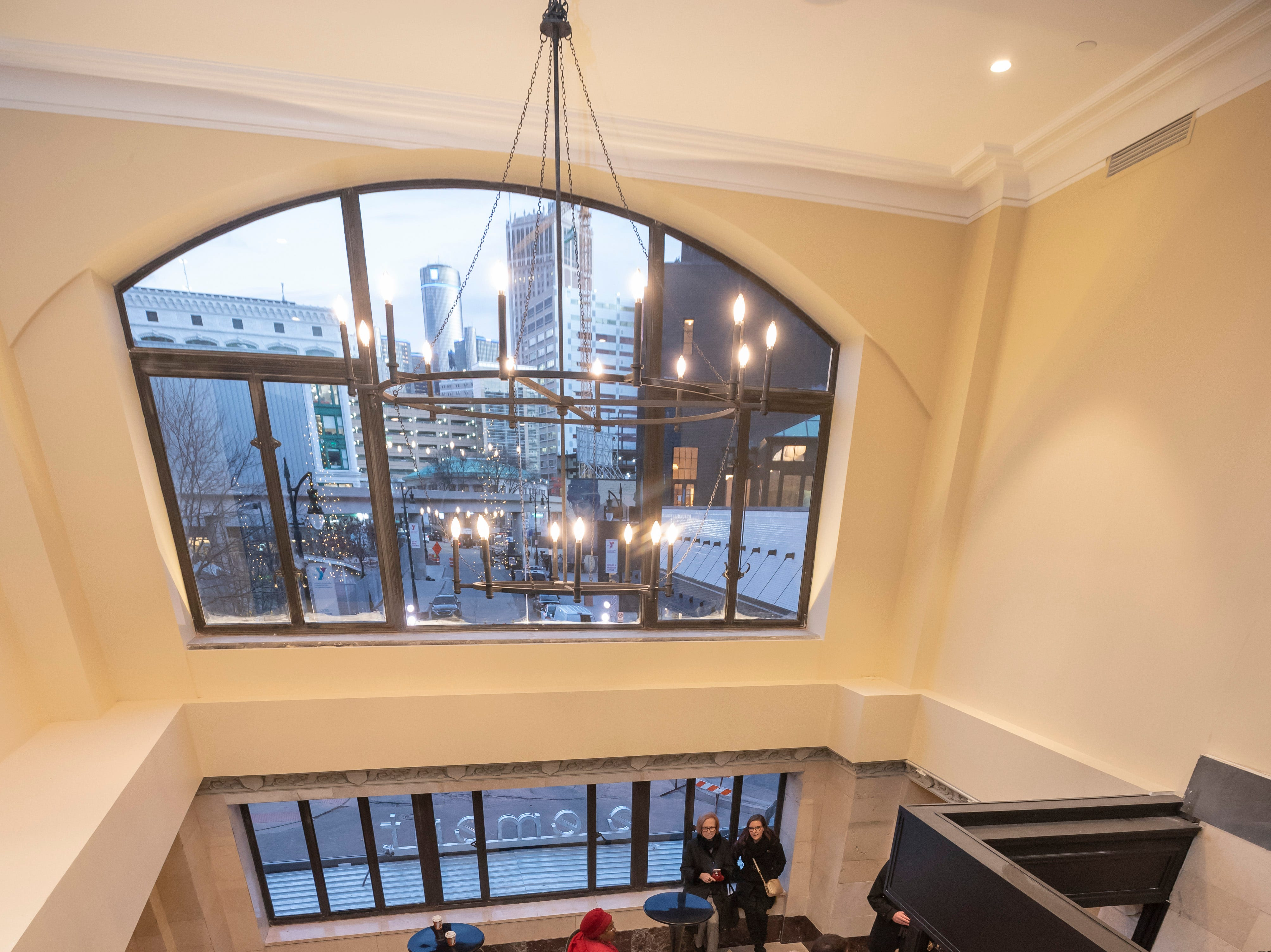 Guests walk up the grand staircase inside the renovated Metropolitan building.