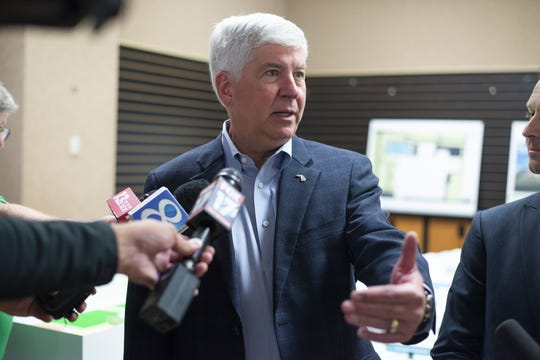 In this July 24, 2018 file photo, Gov. Rick Snyder answers questions after a press conference in Portage, Mich. Snyder officially forgave more than $5 million he had loaned to his campaign when he launched what was considered a long-shot bid for the 2010 gubernatorial election.
