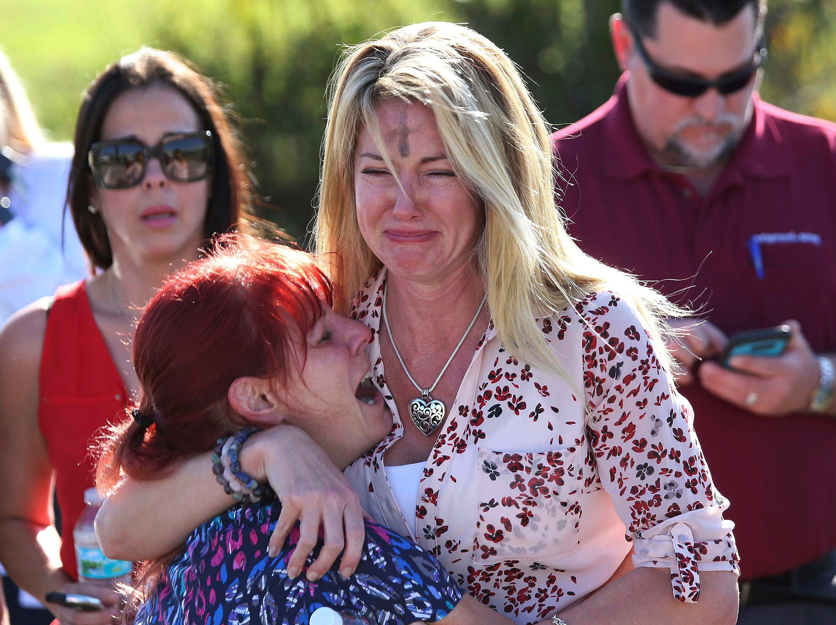 Parents wait for news of their loved ones after a mass shooting at Marjory Stoneman Douglas High School in Parkland, Fla., on Feb. 14, 2018.