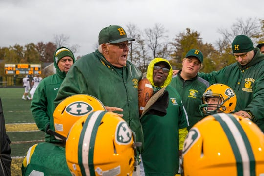 Farmington Hills Harrison head coach John Herrington owns the state record for victories with 443.