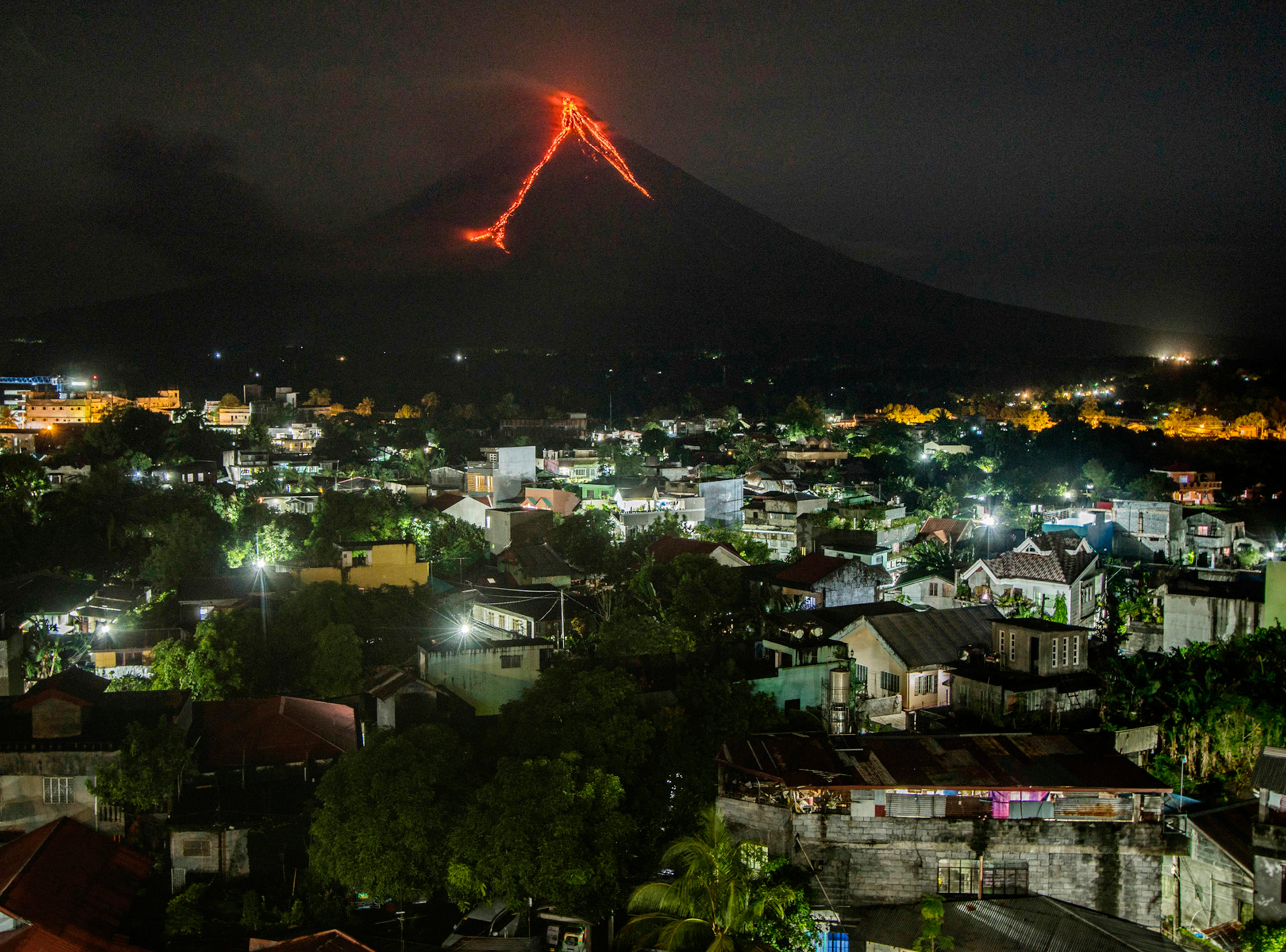 Lava flows down the slopes of the Mayon volcano in the Philippines, seen from Legazpi city, 210 miles southeast of Manila, on Jan. 16, 2018.