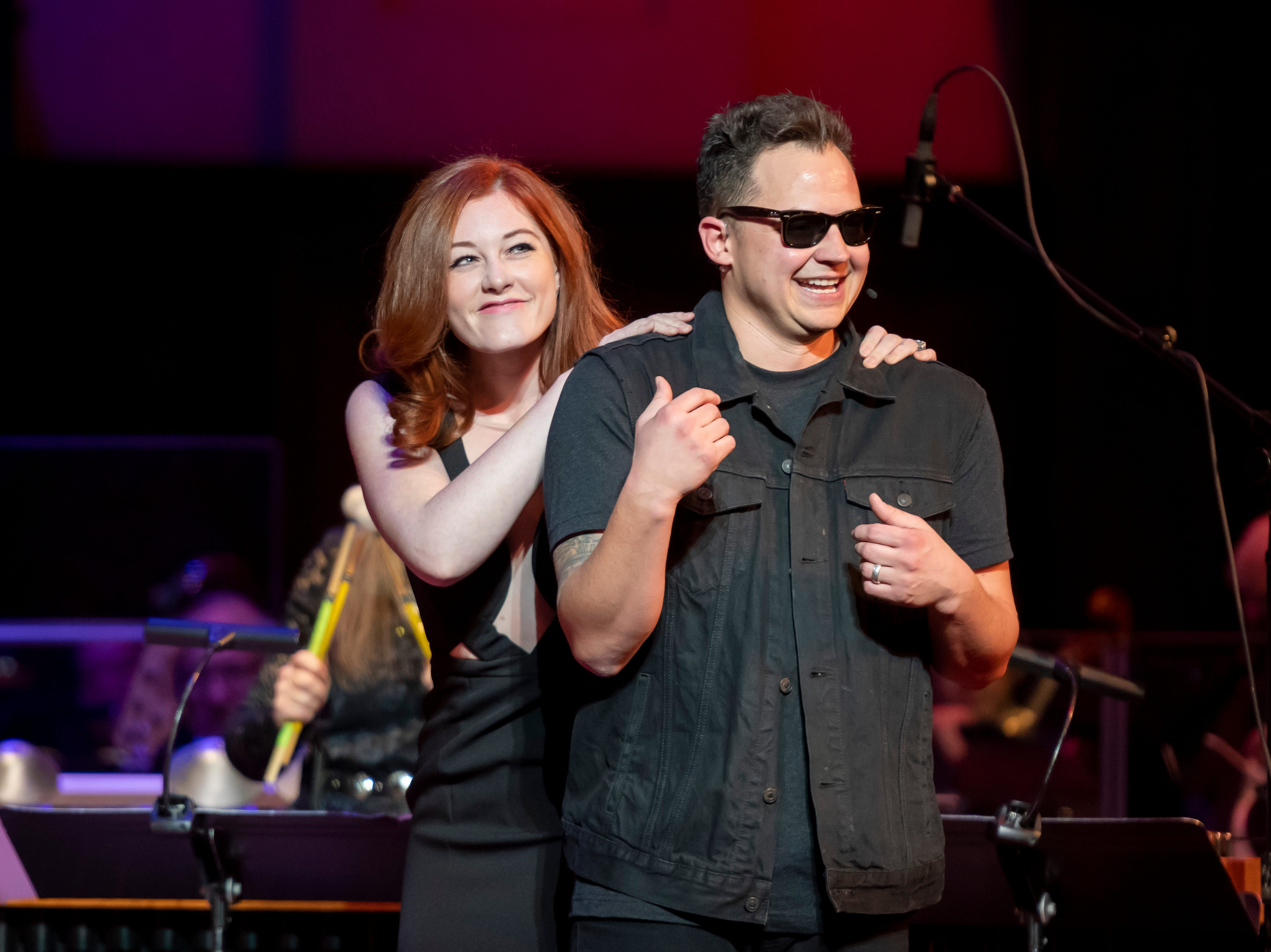 Musician Mandy Harvey, left, joins Sean Forbes on stage.