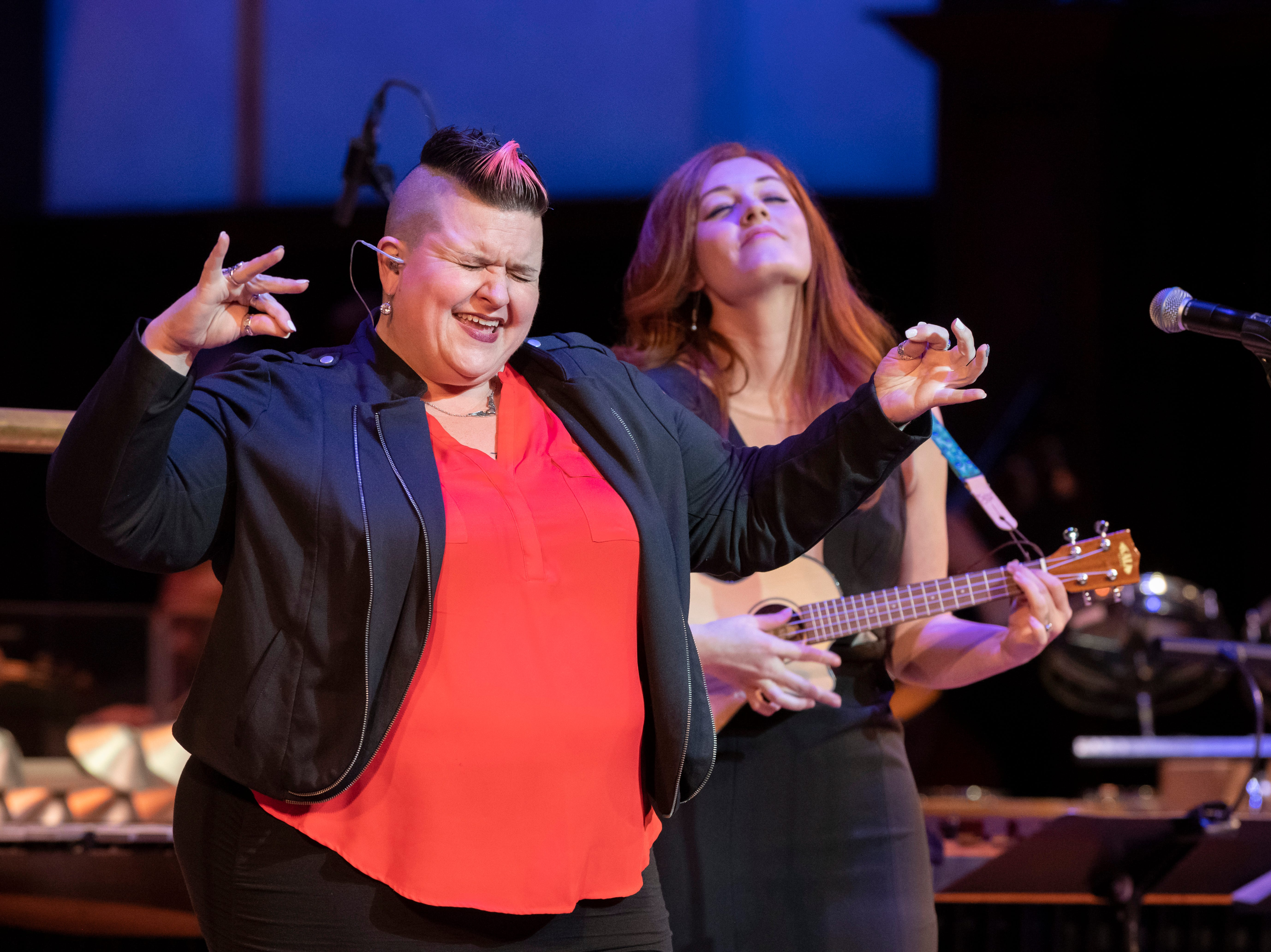 ASL performer Amber Galloway Gallego, left, and musician Mandy Harvey perform during the Deaf and Loud Symphonic Experience at the Detroit Symphony Orchestra.