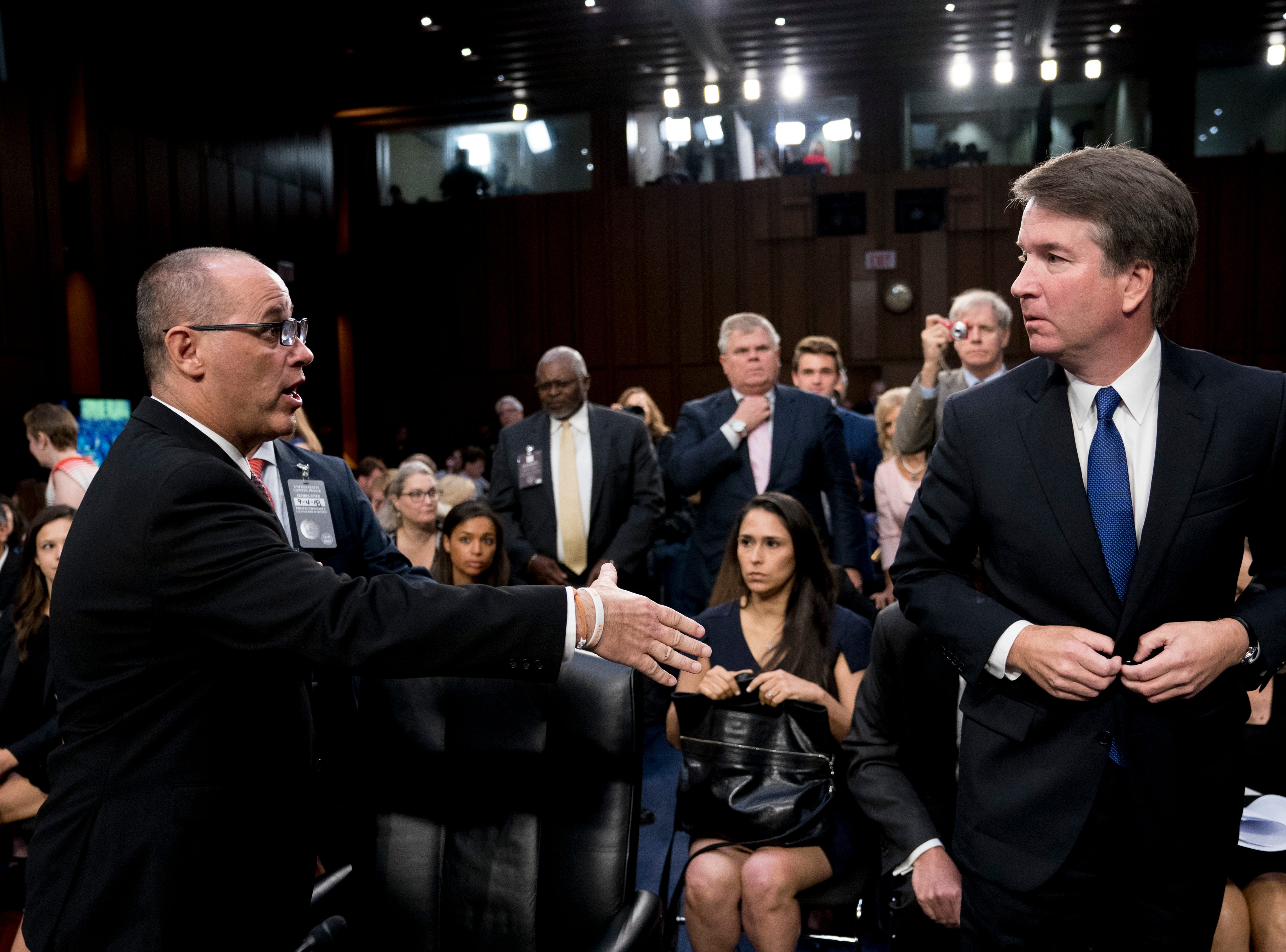 Fred Guttenberg, left, the father of Jamie Guttenberg, who was killed in the high school shooting in Parkland, Fla., attempts to shake hands with then Supreme Court nominee Brett Kavanaugh on Capitol Hill in Washington on Sept. 4, 2018. Kavanaugh did not shake his hand.