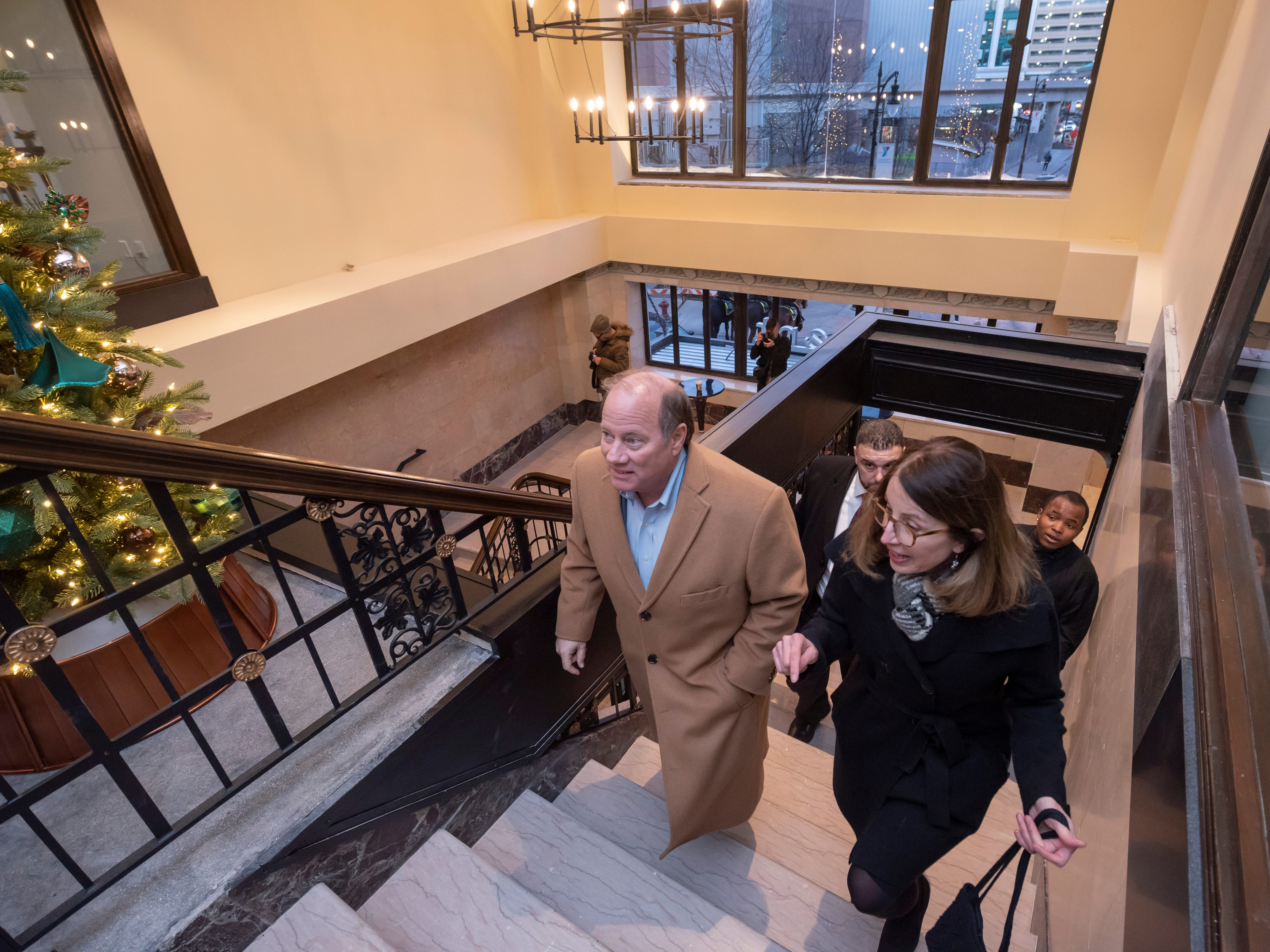 Detroit Mayor Mike Duggan, left, gets a tour from Stacy Fox, a founder and principal of the Roxbury Group, of the inside of the renovated Metropolitan building in Detroit.