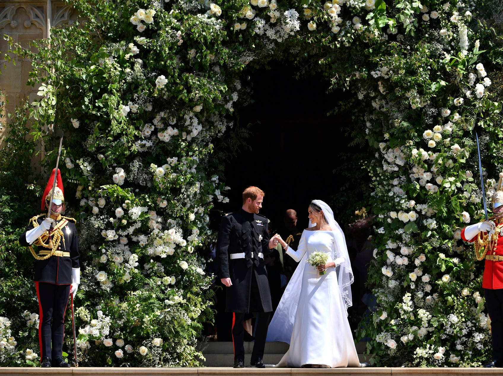 Prince Harry and Meghan Markle leave St. George's Chapel in Windsor Castle after their wedding ceremony in Windsor, England, near London, on May 19, 2018.