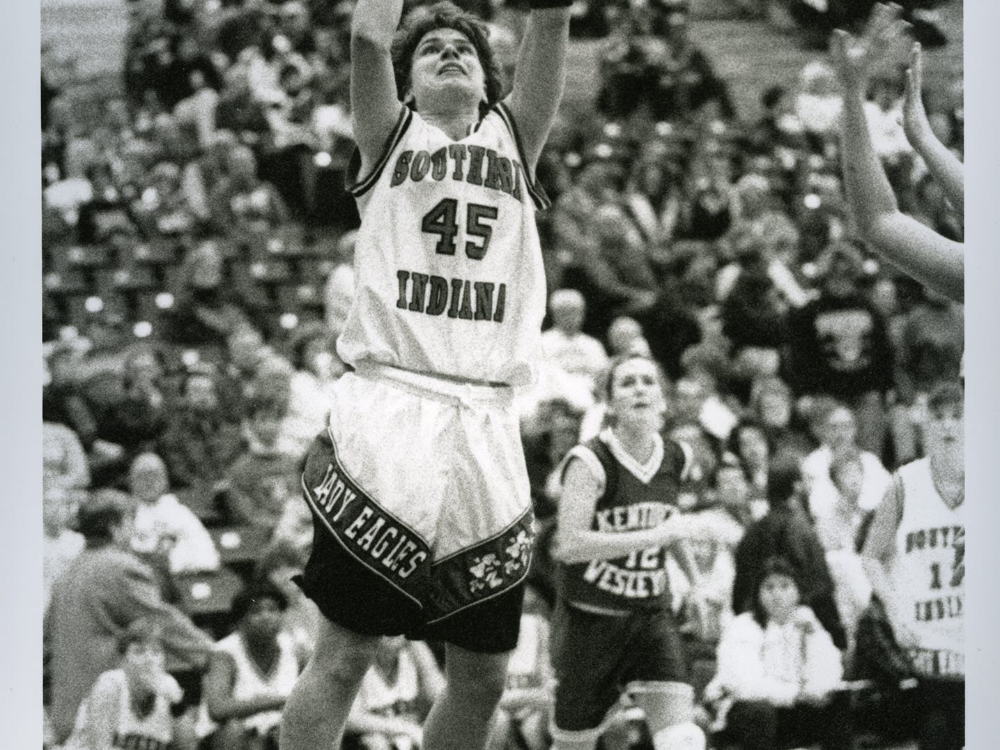 Eileen Weber puts up a shot during her playing days at the University of Southern Indiana.